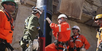 Rescuers prepare the capsule that will free the 33 miners