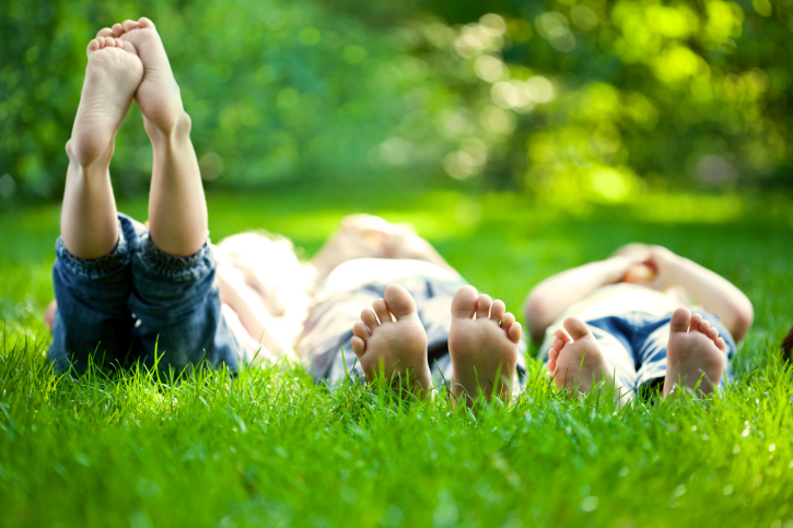 children lying in grass
