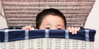 Boy Hiding in Laundry Basket