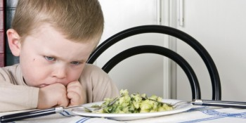 Boy Upset about food at table