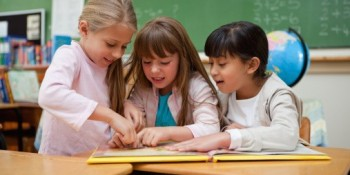 3 girls in school working together friends