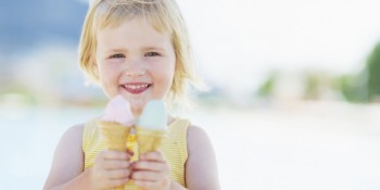 little girl smiling and eating ice cream summer