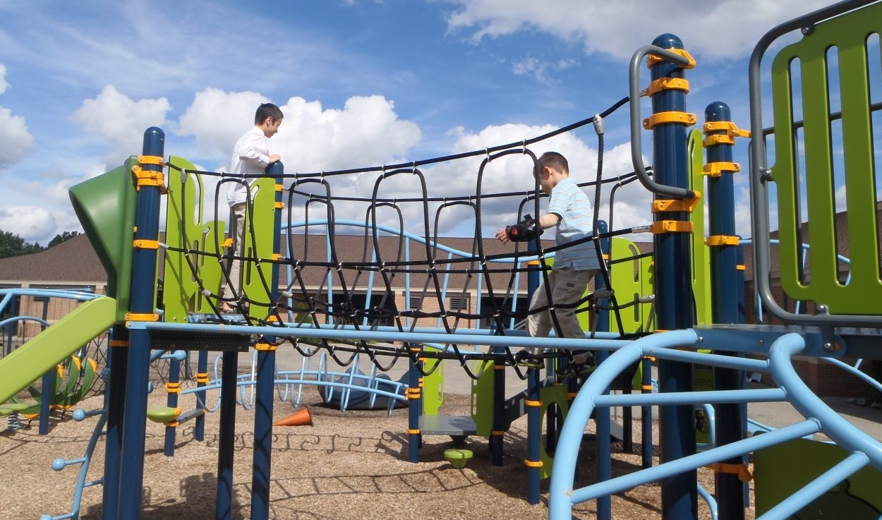 What is an adaptive playground and how can I get one in my neighborhood?