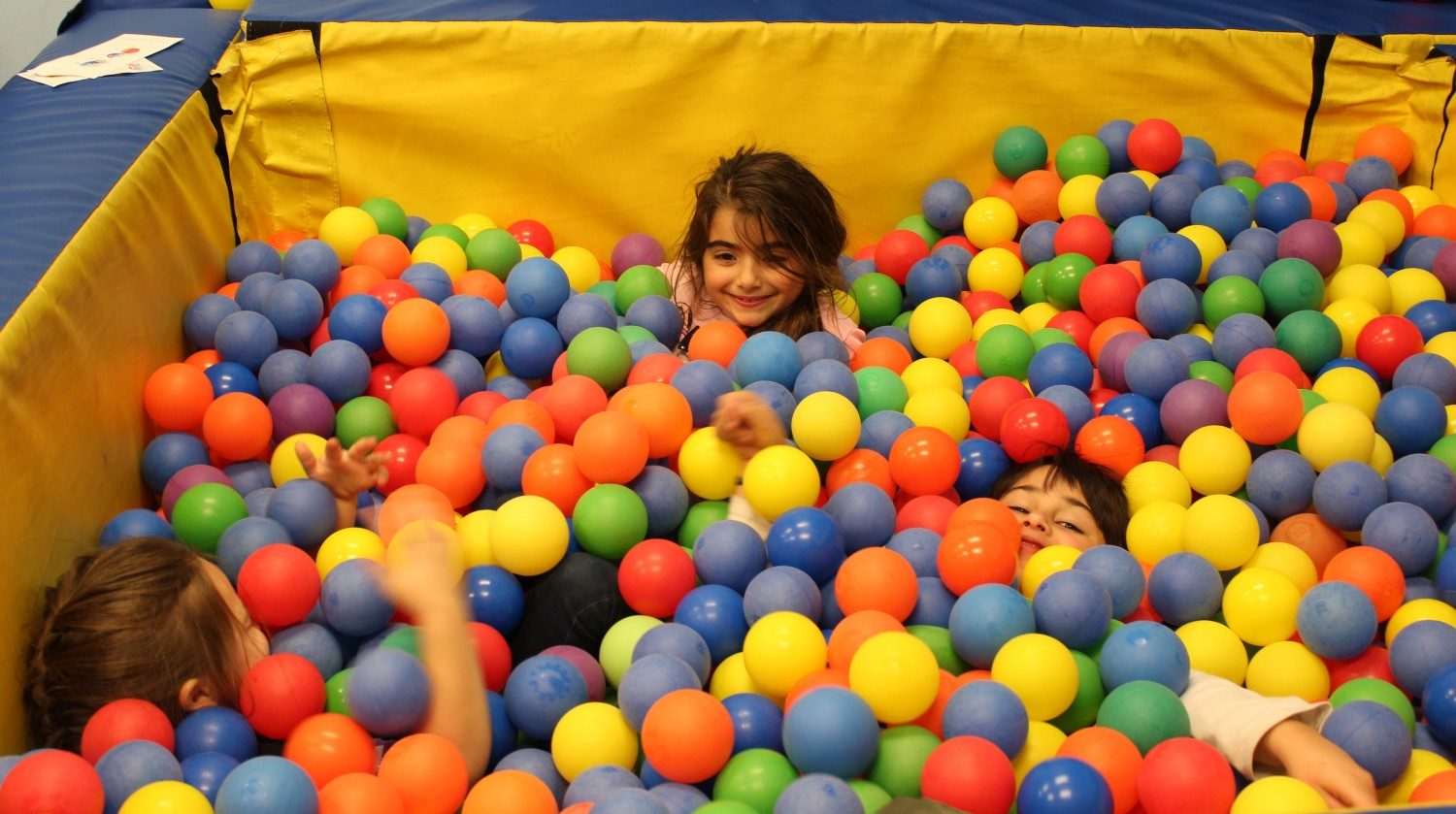 FC kids in ball pit