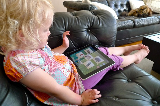 Girl playing on ipad