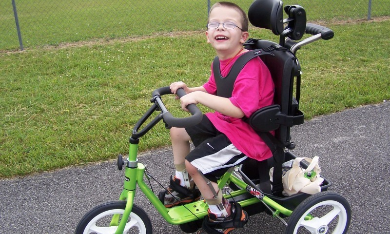 From the winner of a Parent:  Judd, received his Rifton tricycle that he won through your bike giveaway. He loves it so much. His first time out with it , he pedaled .75 miles! Everyone at the track had a smile on their faces watching him enjoy his bike. The biggest smile there belonged to him though.