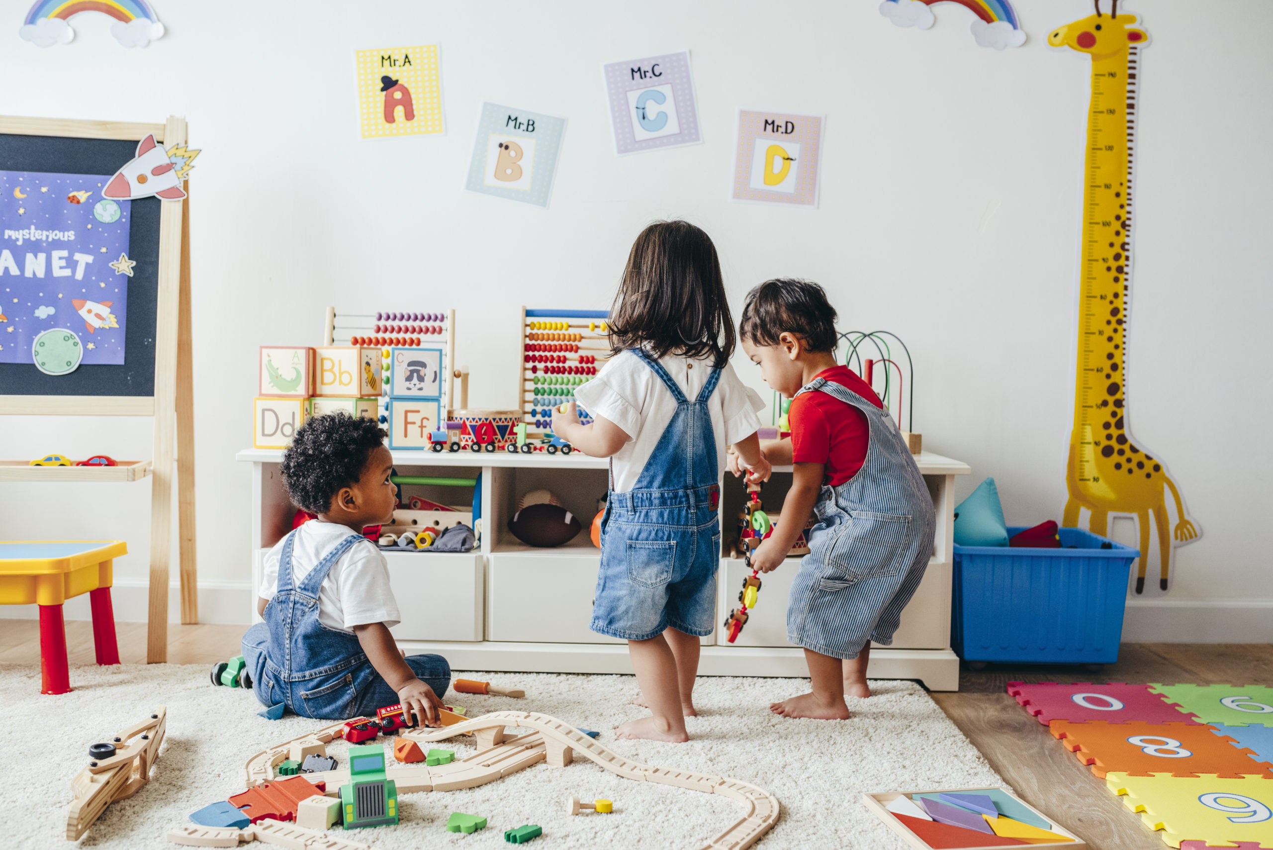 Young children enjoying playing in the playroom