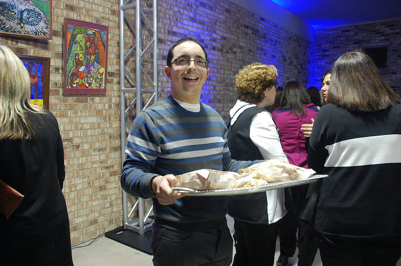 Ben Nadis Distributes Challah at the Art & Soul Event